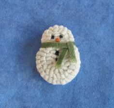 This cute little hooked snowman measures about 2 1\/4 top to bottom. Hooked with 100% hand dyed wool and finished off with a green strip of wool for his scarf.    Completely finished on the back with a piece of felt and a pinback. Finished on all edges with a strip of wool.    Hand dyed snow wool thus a little variation in the coloring. He has an ever so slightly pointed carrot nose.    I have more on hand..please convo me. I can also make up a custom order for as many as you may need…