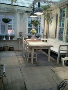 Use of old shutters, random doors, chairs, windows...make a lovely shabby cottage space!