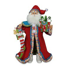 The Whimsy Santa from Karen Didion Originals brings the joy of Christmas into your home. The quality of this figurine is unmatched with its hand-painted face, glass inset eyes, real mohair beard, unique fabric, and detailed accessories. <BR>
