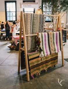 Made by hand in the traditional method, which includes handmade wool, natural and collected dyes and a homemade loom, the Pampa rugs and throws have captured our hearts. Available at Koskela. Scarf Display, Fabric Display, Ladder Display, Showroom Design, Interior Design, Boutique Store Displays, Deco Studio, Retail Store Design, Store Interiors