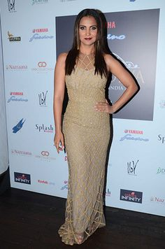 Lara Dutta in a Monisha Jaising dress, Prerto earrings and Jimmy Choo shoes.