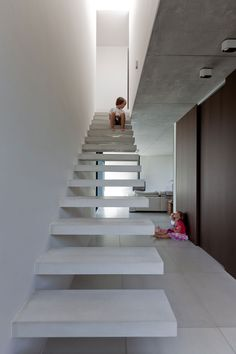 Belgian architectural firm, Areal Architecten, have designed House LV. This modern, 2 story, family home is located in Haacht, Belgium. Its L-shaped floor plan and strategically placed sliding glass walls give this home a spacious feel and invites the outdoors in.                         Photos by: Cafeine © Thomas De Bruyne