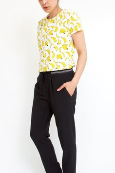 This white cotton t-shirt has us feeling ready for summer with its cute banana print. Style it with jeans and skirts alike for a laid-back cool appeal. From Sienna With Love.
