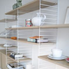 String Shelving System - a shelving system goes around the world String Shelving System string shelf system, white/ oak ENLOTYE Modular Shelving, Shelving Systems, Open Shelving, Office Shelving, Shelving Ideas, Room Shelves, Storage Shelves, Storage Spaces, Kitchen Storage