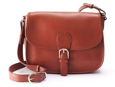 I have a huge leather tote purse which is handy, but I'd eventually like a smaller, cross body purse similar to this one.