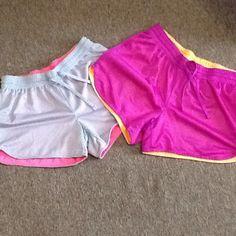 Danskin reversible athletic shorts☀️ Reversible running shorts. Both size small light grey/ hot pink, purple/orange. Super comfy!  Both for $16 or one for $9. Danskin Now Shorts Skorts