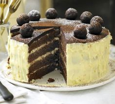 Chocolate, orange and almond simnel cake. A rich, indulgent Easter treat with orange frosting and homemade chocolate marzipan, great for those who don't like traditional fruit cake Chocolate Easter Cake, Chocolate Sponge Cake, Chocolate Orange, Homemade Chocolate, Melting Chocolate, Chocolate Recipes, Chocolate Cakes, Simnel Cake, Orange Frosting