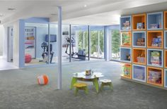 Basement - play area (love the wall organization) and workout room.
