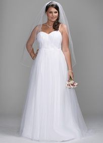 Delicate and ethereal, this tulle gown features a softly shirred sweetheart neckline bodice and beaded straps. Embellishment details accent the natural waist of the full ball gown skirt. Chapel train. Available in White or Ivory. Fully lined. Back zip. Dry clean only.  To protect your dress, our Non Woven Garment Bag is a must have!