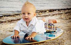 Cute baby on a surfboard: photography for newborn #Surfer #Baby #Babies #NewbornPhotography #Beach #Ocean #PhotoshootIdeas #BabyAtTheBeach #InfantPhotography