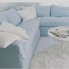 Simple Sectional In Light Blue With Textural Whites Mixed In. All Available  To Order At