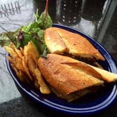 BLUE PLATE SPECIAL 3-4-15: CUBANO SANDWICH  Baked Citrus Tofu & house-made Seitan grilled on a pressed Iggy's French sandwich roll with mustard, garlic mayo, house pickles & Swiss, Daiya, or house vegan cheese. Served with dressed greens and choice of slaw, potato salad or chips.  #vegan #vegetarian www.veggiegalaxy.com
