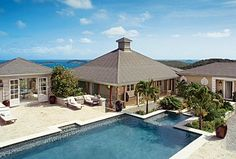 The retreat on the island of Mustique features mahogany ceilings, West-Indies inspired finishes, and furniture from Bali