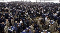 In this Feb. 20, 2013 photo, nearly 3,000 cadets stand listening to announcements before eating lunch together inside the dining hall at the U.S. Air Force Academy, north of Colorado Springs, Colo. The Colorado economy could lose more than $48 million in wages over the next few months if automatic spending cuts take effect, a Colorado Springs business official said Thursday. That total is for civilian employees at Air Force installations alone, said Andrew Merritt, chief defense industry…