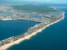 """The city of Lobito is long considered """"the guest room of Angola"""" . Located on the south-central Angolan coast, in the province of Bengu. Seychelles, Uganda, Holiday Destinations, Travel Destinations, Paises Da Africa, The Province, Sandy Beaches, Aerial View, Tourism"""