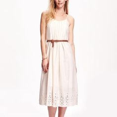 "Midi Eyelet Hem Slip Dress Gorgeous dress for spring and summer! Vneck, adjustable straps with a smocked back. Zipper closure at the side. Fully lined with pleat detailing in the front and back. 100% cotton, hits below the knee. 47"" long and 16"" pit to pit. Old Navy Dresses Midi"