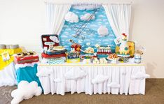 Travel theme baby shower- travel clouds dessert display sweets table retro modern bright yellow red and blue