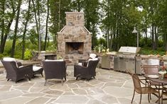 outdoor kitchen fireplace to your patio space gives you more room for entertaining your friends. The more elaborate outdoor kitchen fireplace Modern Outdoor Kitchen, Patio Kitchen, Summer Kitchen, Outdoor Spaces, Outdoor Living, Outdoor Decor, Outdoor Kitchens, Fireplace Kitchen, Kitchen Flooring