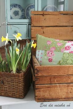 Add a basket with daffodils in a basket with a wooden chest for pillows and blankets