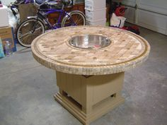 How to make a wood table into an outdoor fire pit with Glassel fireglass.