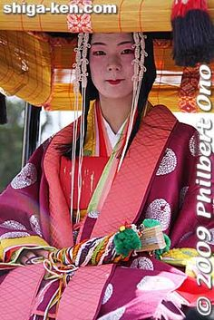 A Saio princess dressed in a beautiful, juni-hitoe, 12-layer kimono will be carried in a palanquin escorted by a bevy of women in kimono.