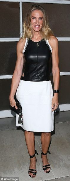 Lightening things up: Kelly Lynch wowed in an edgy monochrome ensemble while actress Elaine Hendrix wowed in a white pantsuit