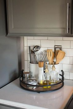 A builder grade kitchen gets a new look featuring gray cabinets, Quartz counters and subway tile. An inspiring, must-see kitchen before and after reveal! Diy Kitchen Cabinets, Kitchen Cabinet Organization, Grey Cabinets, Kitchen Countertops, Organization Ideas, Soapstone Kitchen, Laminate Countertops, Kitchen Cupboard, Kitchen Tile