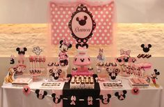 Pink Minnie Mouse birthday party dessert table! See more party ideas at CatchMyParty.com!