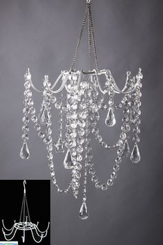 Create your very own chandelier decoration using our white metal frame! Just add your own beads, flowers, or anything you'd like! We have a HUGE selection of  Bead Strands an