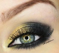 Yellow -> black shadow. Line the upper and lower inner waterline with black eyeliner and finish by sweeping black shadow underneath