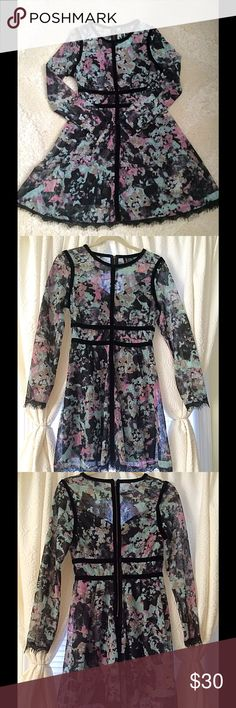 Floral Print Lace Dress Fire. Blue and Pink Floral Print Lace Dress. Black Velvet Accents. Long Sleeves. Above The Knee. Size Large (Runs Small, More Like A Medium) Only Worn Once. Fire Los Angeles Dresses
