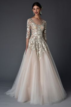 Your wedding dress will surely shine with this amazing metallic embroidery trend!