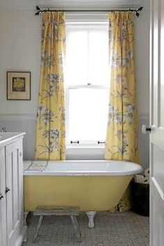 From Sarah's House...love the yellow claw foot tub and toille curtains!