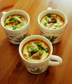 Tofu Chawanmushi (japanese egg custard) - my current version.  Separate the ingredients (spring onions, mushrooms, achovies) into the bowls  Blend 1 package of tofu, 3 eggs, mirin, 2 Tbsp shitake water (the water you have left after soaking shiitake.  Cover with plastic wrap and steam for 13 minutes or until just set.