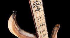 Custom inlay Nordic runes and Yggdrasil tree on a bass guitar