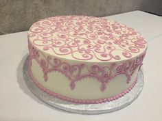 pink s-scrolls with arches birthday cake