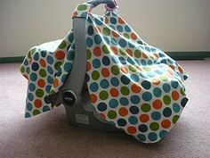 These car seat covers look so awesome, but they are SO expensive!  They'd be pretty cheap to make, though!  :)