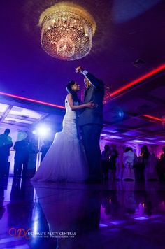 Wedding photography & DJs at Royal Manor in Garfield, NJ provided by Ultimate Party Central - spot light first dance