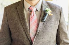 Note the shotgun casing. Yes. This is a manly boutonniere! http://onthegobride.com/2015/06/rustic-groveland-florida-wedding    http://www.landonhendrick.com/