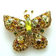 Lots of figural jewelry, like this Yellow Rhinestone Butterfly Pin will be 50% off during the Ruby Lane Red Tag Sale - this Thursday 8AM PST until Sunday 8AM PST.  Browse previews now and wish list your favs!!