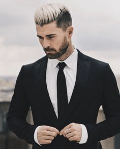 A short beard can be balanced out with the short sides of an undercut and with a light top as this example shows. http://attireclub.org/2015/11/18/undercut-and-beard-combination/ #beard #undercut #men