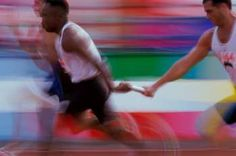 action shot of men's relay race #sports #run #actionphotography #motionphotography #creative #photo #stockphoto #purestock #race