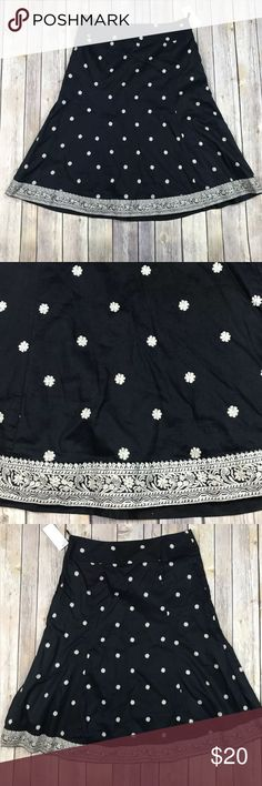"""NWT Gap Women's Black Ivory Floral A-Line Skirt NWT Gap Women's Black Ivory Floral A-Line Skirt SZ 4  CONDITION: New With Tags- Retail $49.50 MEASUREMENTS are Approximate, laying flat & not stretched. 24"""" Waist 24""""  long-laying flat & not stretched GAP Skirts A-Line or Full"""