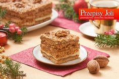 ORZECHOWIEC Składniki: Ciasto: 600 g mąki pszennej 0,75 szklanki cukru 2 jajka 2 żółtka kostka margaryny (250 g) 3 łyżki mleka 3 łyżki miodu 2 łyżeczki sody 1 opakowanie cukru waniliowego Polewa or...
