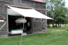 This is our third one, and each time they get a little better.  We built this awning off of the barn we live out of in the summer time.  It's very simple and very cheap to make AND it works very well. If you want to put up a quick and easy shade awning, this basic design can be adapted to work in many situations...