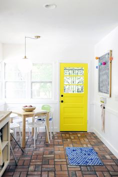 love the bright door in kitchen - want to do this in our space! (from A Beautiful Mess)