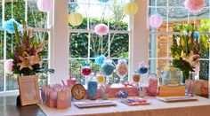 Fun treat table for a sweet shop birthday party. Fun hanging lanterns and candy jars....cute polka dot gift bags...and check out that adorable teapot birthday cake! This was an Alice in Wonderland birthday party but very adaptable to Mary Poppins and other ideas...