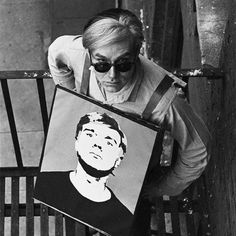 Andy Warhol with a self portrait.