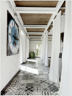 hydraulic/encaustic/cement tile floors with patchwork design.