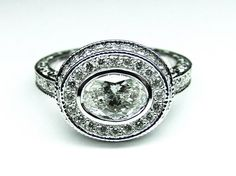 Custom Made Horizontal Oval Diamond Engagement ring bezel set with halo and engraved band in 14K White Gold ES839